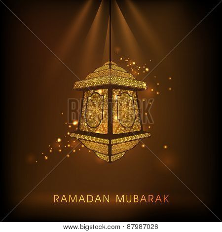 Hanging golden intricate arabic lantern on shiny brown background for Islamic holy month of prayers, Ramadan Kareem celebrations.