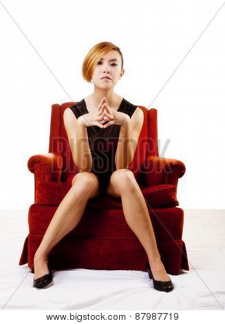 Slim Asian American Woman Sitting In Chair