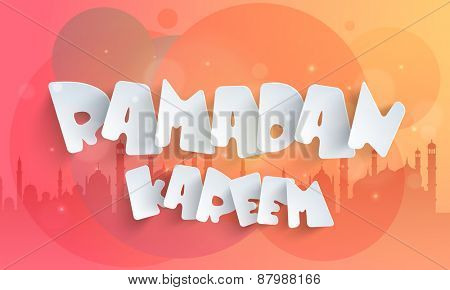 Paper text Ramadan Kareem on colorful islamic mosque silhouette background, Concept for Islamic holy of prayers celebrations.