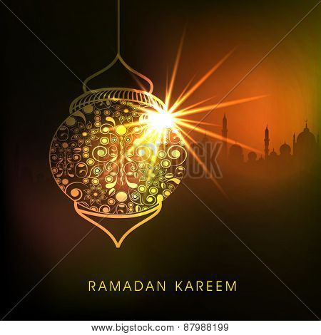 Golden floral design decorated shiny lamp on mosque silhouette background for holy month of Muslim community Ramadan Kareem celebration.
