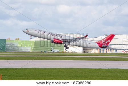 Manchester, United Kingdom - April 11, 2015: Airbus A330 Virgin Atlantic Just Taken Off From Manches
