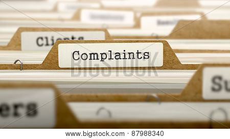Complaints Concept with Word on Folder.