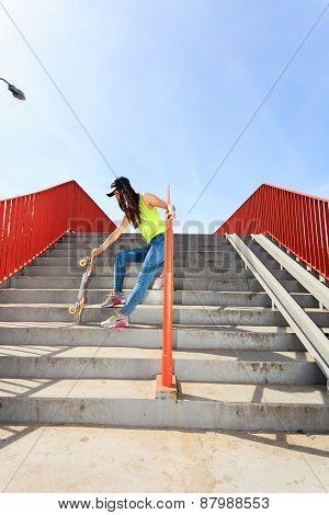 Summer Sport. Cool Girl Skater Riding Skateboard