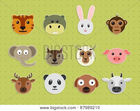 Set of various wild and pet animals faces on green background.