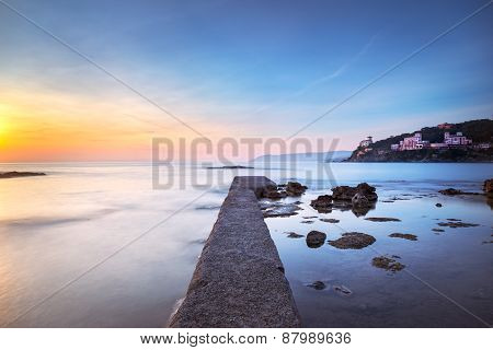 Castiglioncello Bay Concrete Pier, Rocks And Sea On Sunset. Tuscany, Italy.