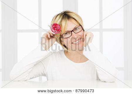 Forty years woman with glasses and rose