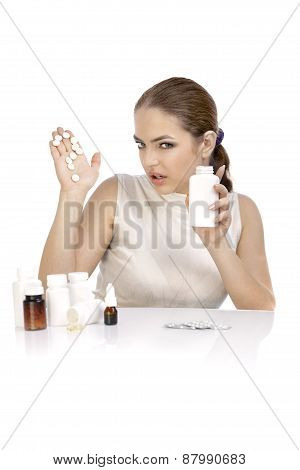 Young Woman Showing Question Mark Made From Pills On Palm