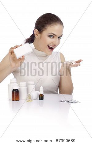 Beautiful Smiling Young Woman Showing A Pill Bottle
