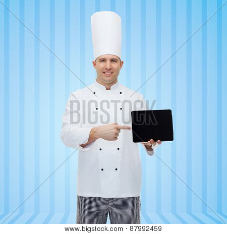 cooking, profession and people concept - happy male chef cook showing tablet pc computer black blank screen over blue striped background