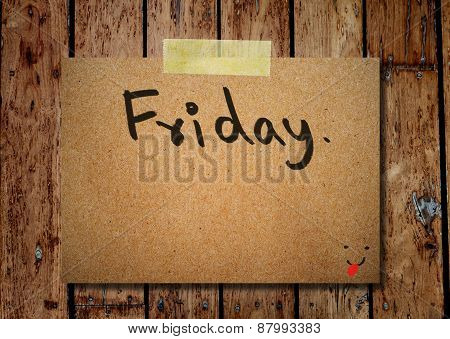 Friday On Note Paper With Wooden Background