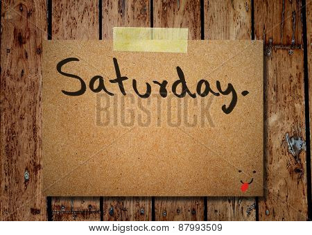 Saturday On Note Paper With Wooden Background