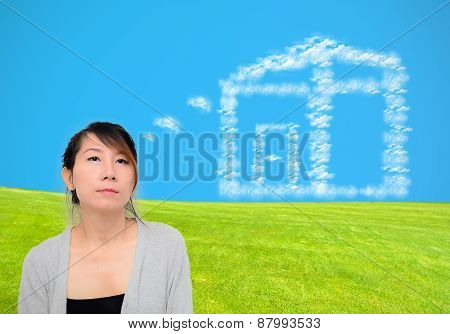 Woman Thought Dream Cloud House On Green Field With Blue Sky