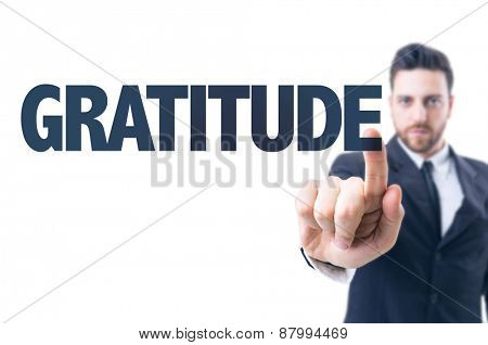 Business man pointing the text: Gratitude