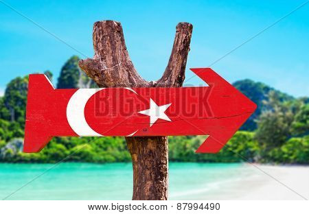 Turkey Flag wooden sign with beach background