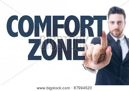 Business man pointing the text: Comfort Zone