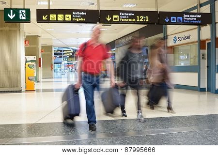 VALENCIA, SPAIN - APRIL 11, 2015: Airline passengers inside the Valencia Airport. About 4.59 million passengers passed through the airport in 2013.