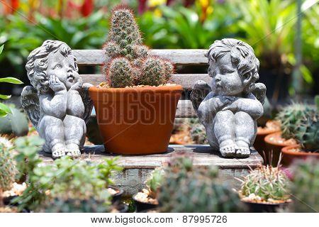 Twin cupid in the garden.background blur