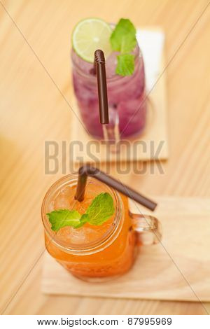 Purple and orange juice in a restaurant in the evening.