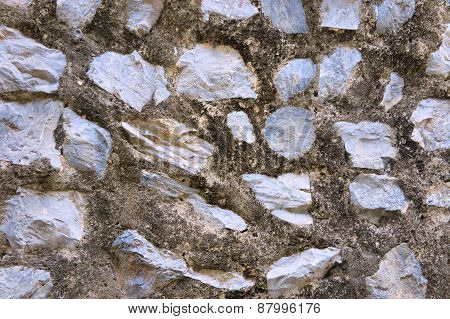 Wall built of old stones. Stone wall. Abstract Background.