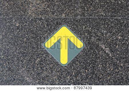 arrow sign on black cement floor