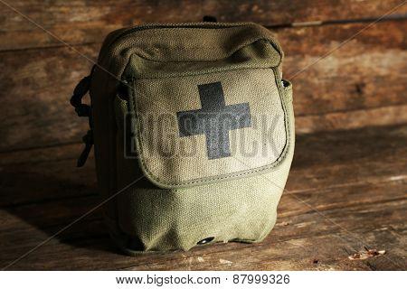 Medicine chest on wooden background