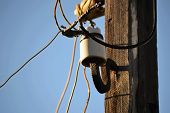 stock photo of utility pole  - The old wooden pole power supply wiring and vintage insulators retro - JPG