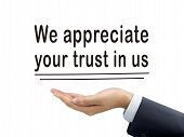 stock photo of trust  - we appreciate your trust in us holding by businessman - JPG