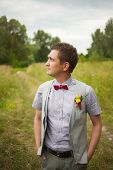 picture of boutonniere  - Portrait of handsome young man smartly dressed - JPG