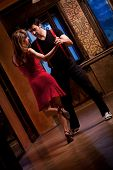 stock photo of tango  - A man and a woman in the most romantic dance - JPG