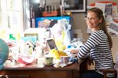 stock photo of untidiness  - Woman Running Small Business From Home Office - JPG