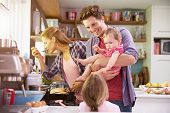 pic of 11 year old  - Family Cooking Meal In Kitchen Together - JPG