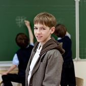 pic of schoolboys  - Portrait of a schoolboy at blackboard background - JPG