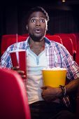 image of cinema auditorium  - Happy young man watching a film at the cinema - JPG