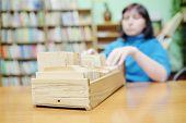 stock photo of librarian  - Librarian woman searches something in card catalog - JPG