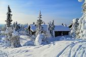 stock photo of laplander  - Holiday cabins and cottages on snowy mountains Lapland Finland - JPG