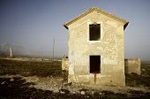 stock photo of abandoned house  - abandoned house in the countryside between fog - JPG