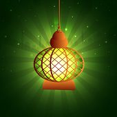 stock photo of dua  - Hanging illuminated traditional lantern on green rays background for islamic holy month of prayers - JPG