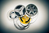 picture of mm  - Heap of super 8 mm movie reels different colors old condition objects and vintage color effect - JPG