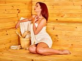 picture of sauna woman  - Young woman relaxing in sauna - JPG