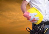 stock photo of labourer  - Worker holding tool with Twilight time on Labour Day - JPG