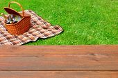 Постер, плакат: Picnic Tabletop Close up Picnic Basket And Blanket On The Lawn