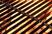 stock photo of flames  - Empty Hot Barbeque Charcoal Flaming Grill Grill Background - JPG