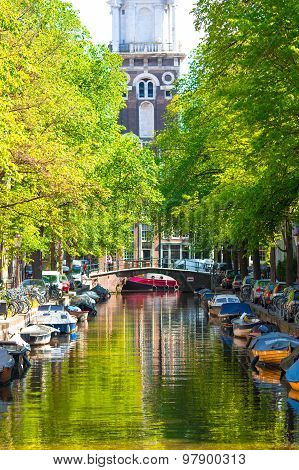 Beautiful Groenburgwal canal in the old city of Amsterdam, Netherlands, North Holland province.