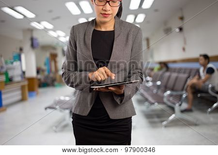 Woman In A Hospital Waiting Room
