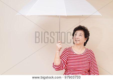 Asian Woman Holding Umbrella In Studio Shot, On Reddish Yellow Gray Wall Background