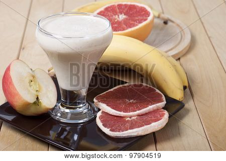 Smoothie Of Banana, Apple And Grapefruit With Yogurt