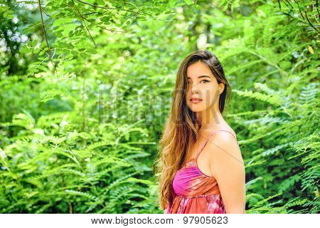 Portrait Of A Young Beautiful Woman In The Summer Green Park