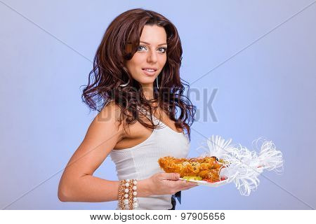 Waiters carrying hold  plates with meat on blue background