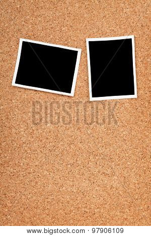 Polaroid photo frames on cork texture background with copyspace