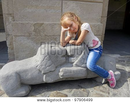 Little Girl Sitting On The Lions Sculpture